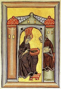 Hildegard von Bingen, receiving a vision (that is the holy fire of inspiration coming to her head from above)