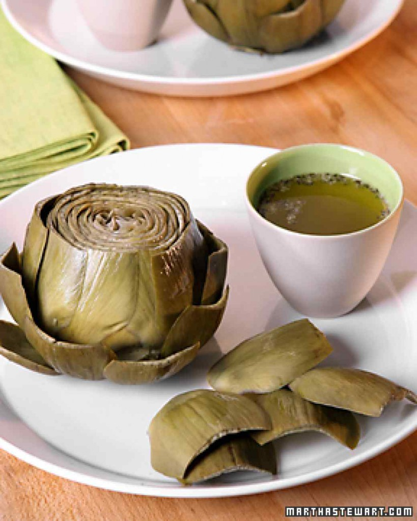 image of a steamed artichoke on a plate from Martha Stewart dot com