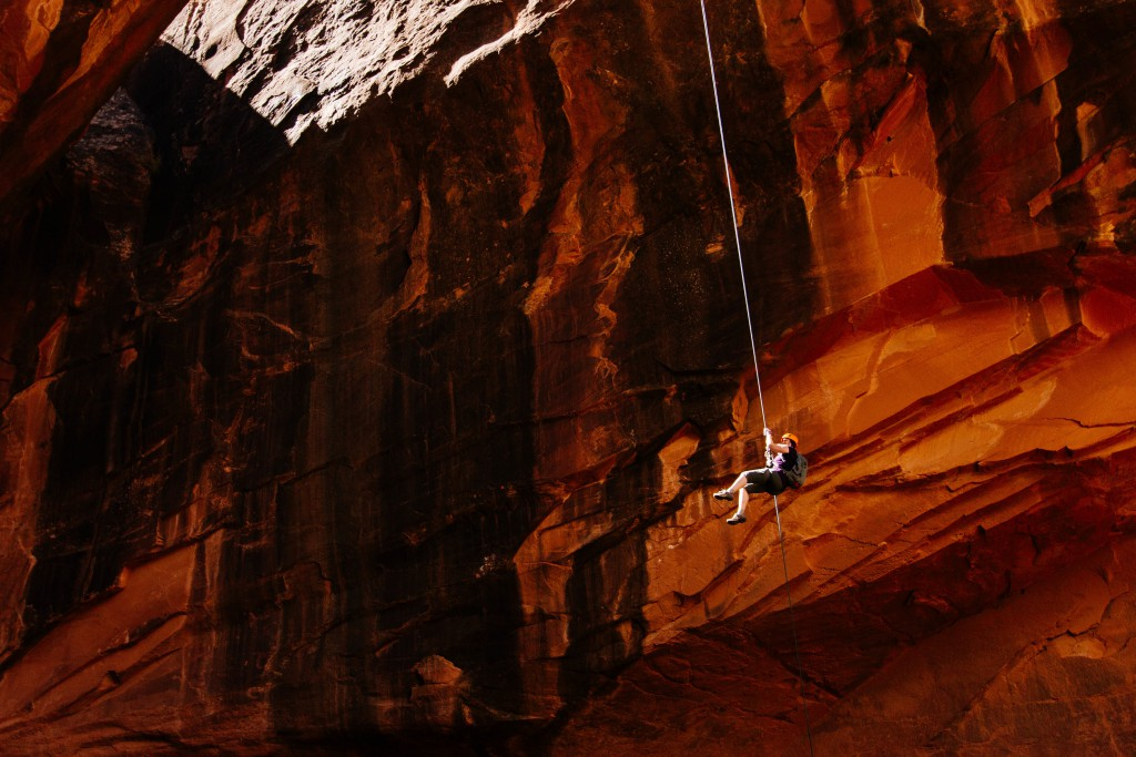 a rock climber suspended on the rope at Moab