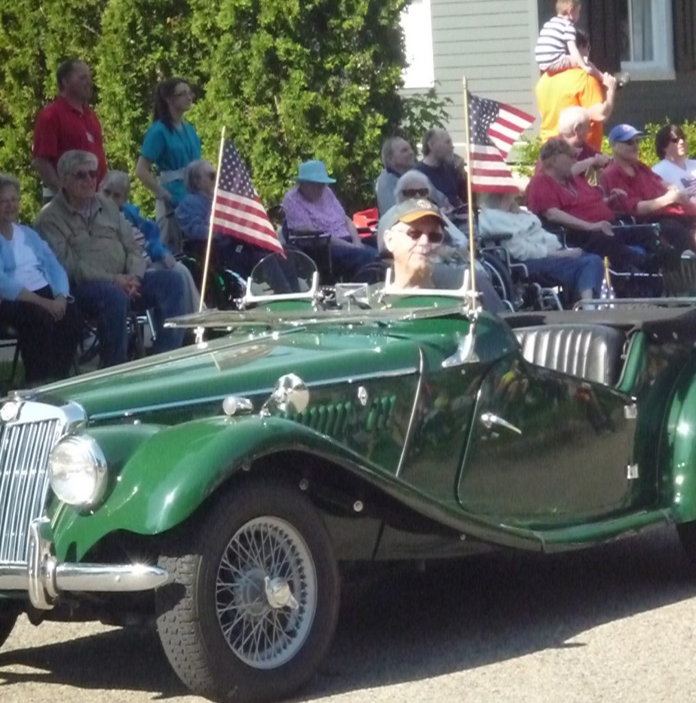 Here's my dad driving in a small-town Memorial Day parade.