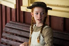 a still image of Anne waiting for Matthew at the train station