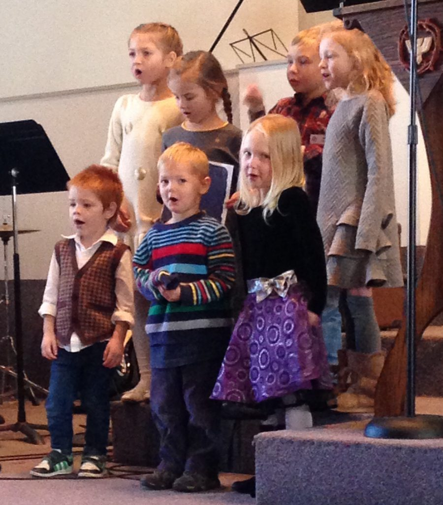 Seven kids, ages 3-6 sing in a choir.